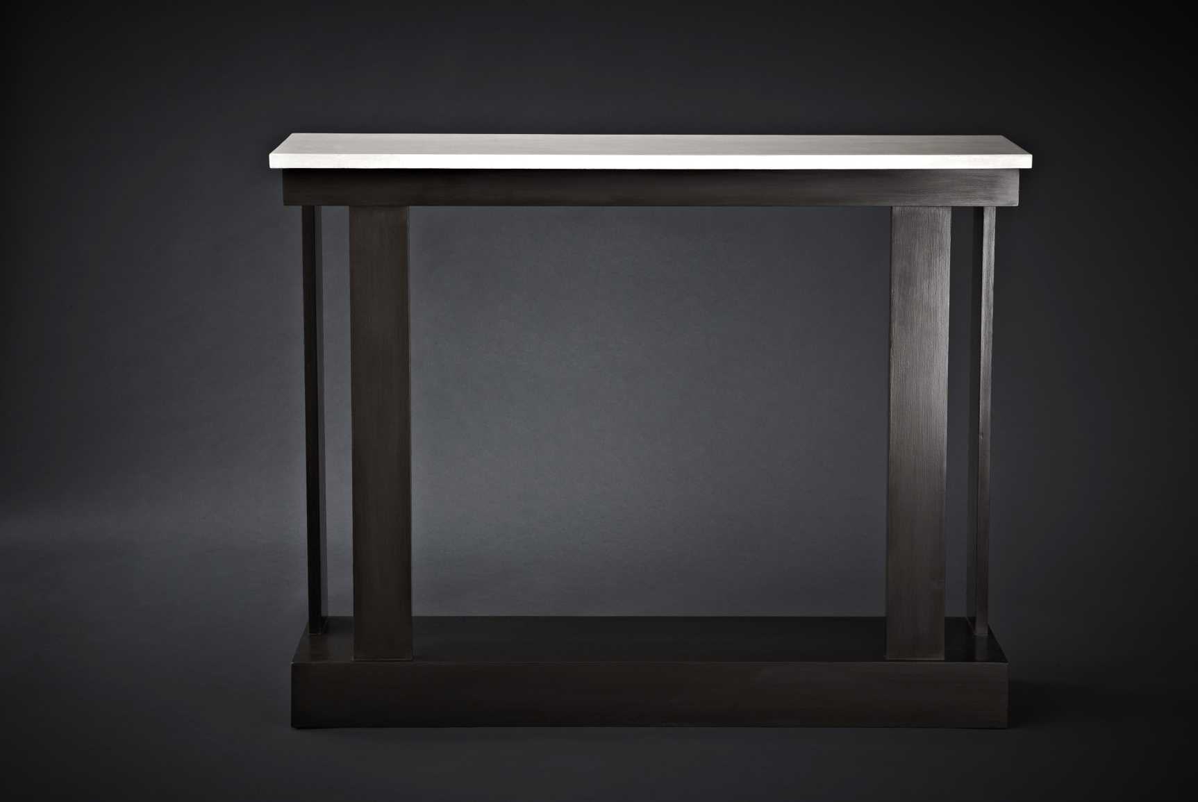 Art Deco inspired console table finished in dark bronze with a faux cracked vellum top