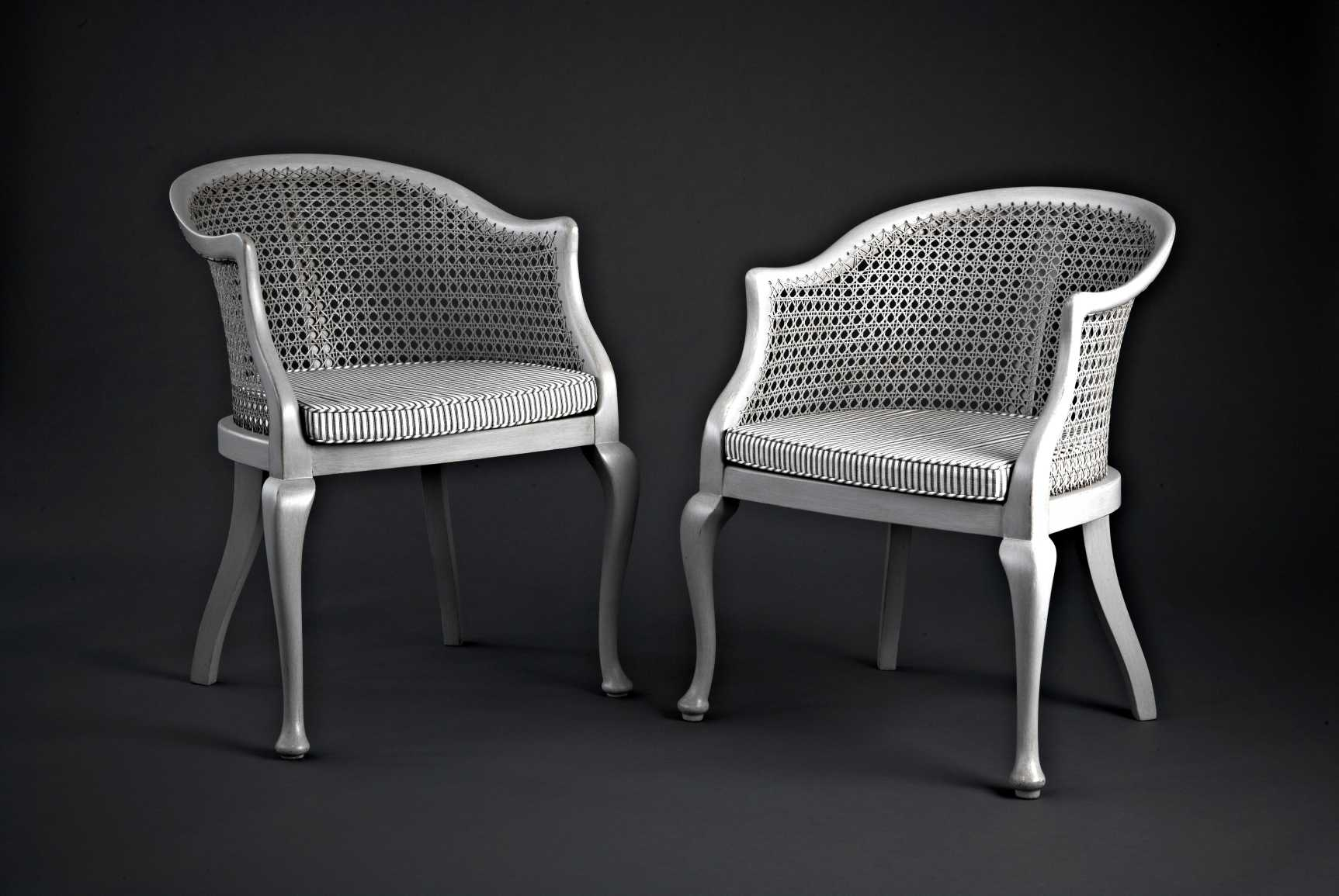Pair of 20th Century French Chairs. Recaned and finished in a soft aged chalky grey paint with squab cushions in Ian Mankin fabric