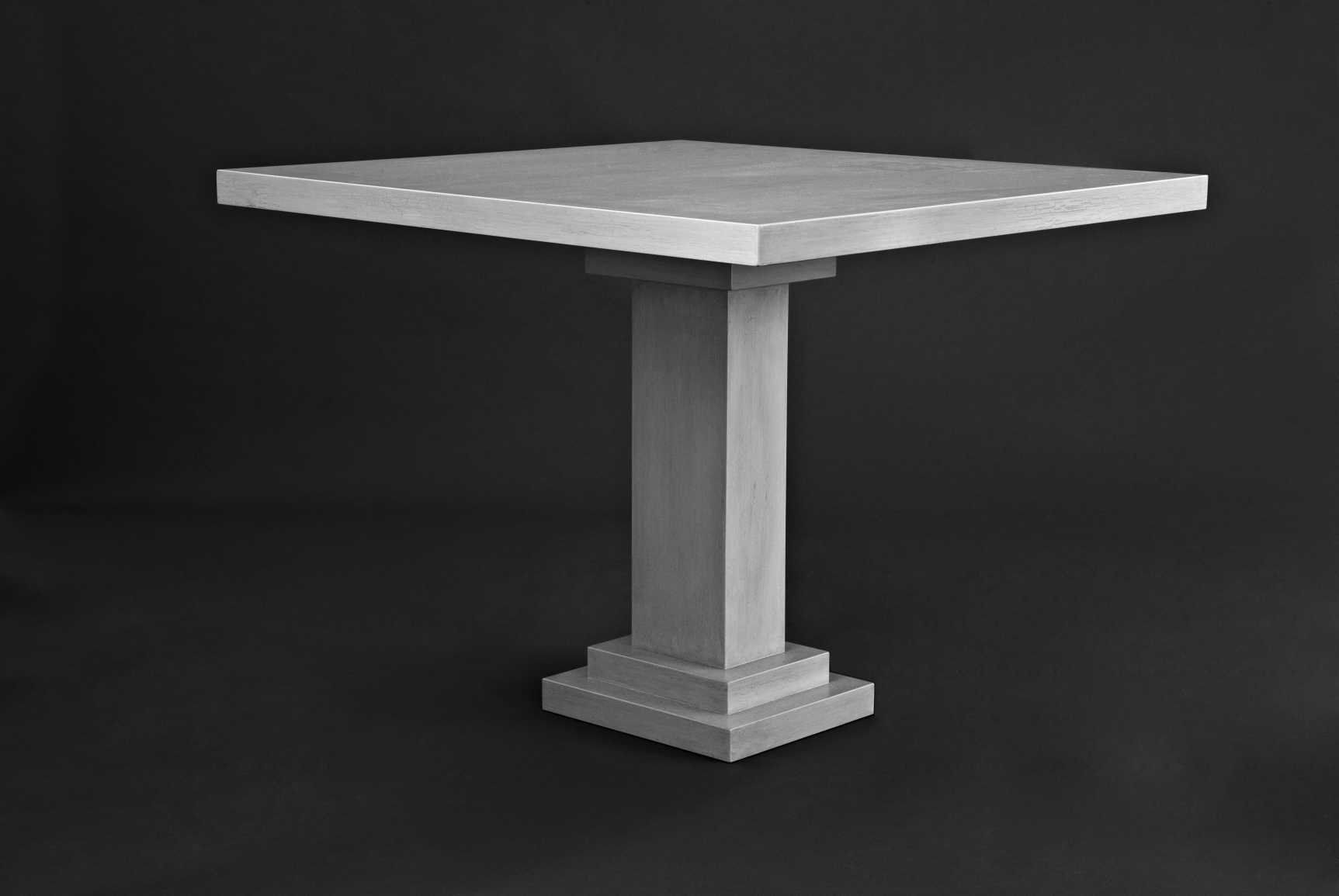 Single pedestal table finished in a lacquered crackle distemper